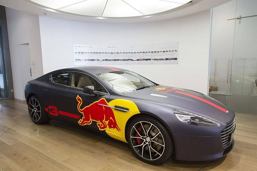 An Aston Martin Rapide S luxury automobile featuring Red Bull GmbH branding sits on display at an Aston Martin Lagonda Ltd showroom in Singapore, on Sept 19, 2017.