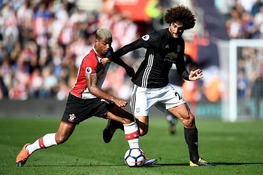 Southampton's Mario Lemina in action with Manchester United's Marouane Fellaini.