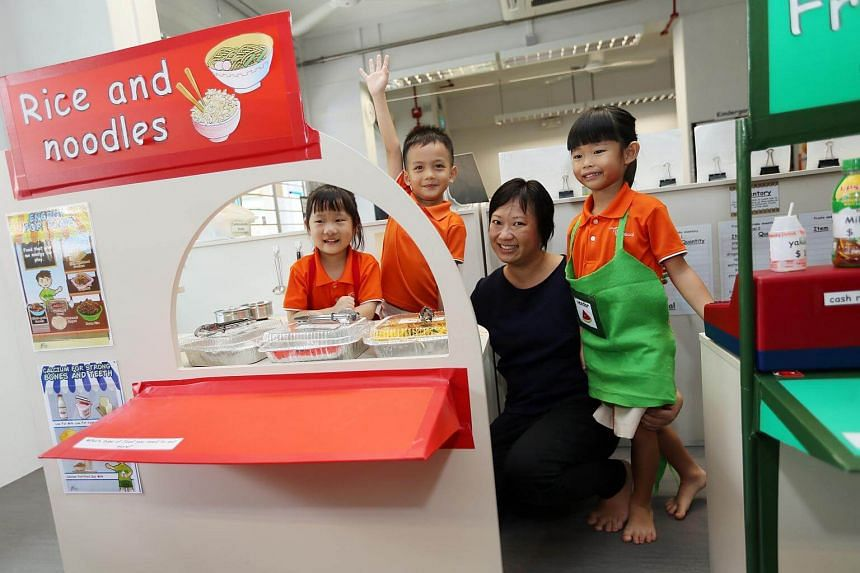 Ms Karina Anne Lee, 38, with some children from My First Skool in Toa Payoh.