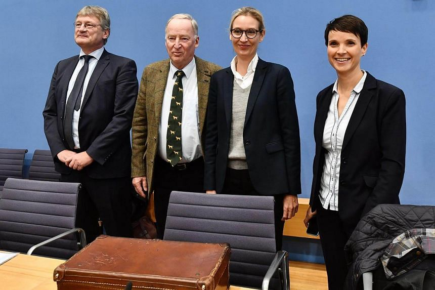 (From left) Members of the hard-right party AfD (Alternative fur Deutschland) Joerg Meuthen, Alexander Gauland, Alice Weidel and Frauke Petry pose before attending a press conference on Sept 25, 2017 in Berlin.