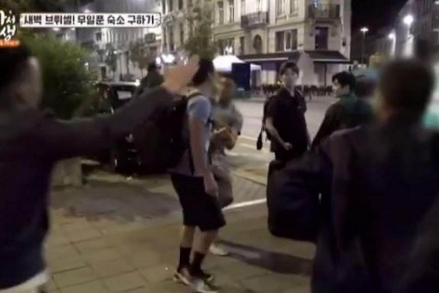 Three passers-by on the street surrounded  South Korean singer Park Joon Hyung, grabbed his backpack and tried to get his watch off him.