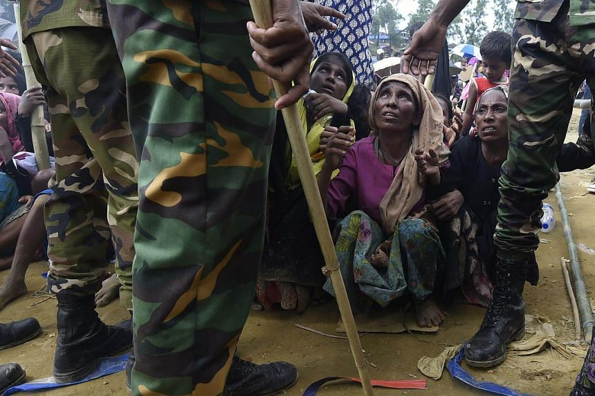 Rohingya refugees wait for food distribution organised by the Bangladesh army at the refugee camp of Balukhali in Bangladesh.
