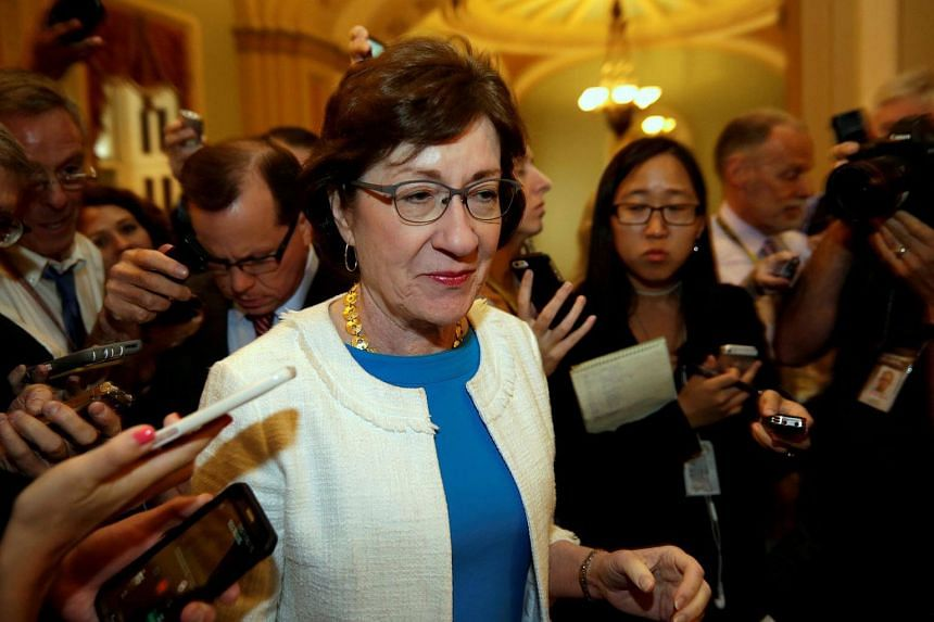 US Senator Susan Collins talks to reporters as she arrives for a Senate healthcare vote on Capitol Hill in Washington, DC, on July 27, 2017.