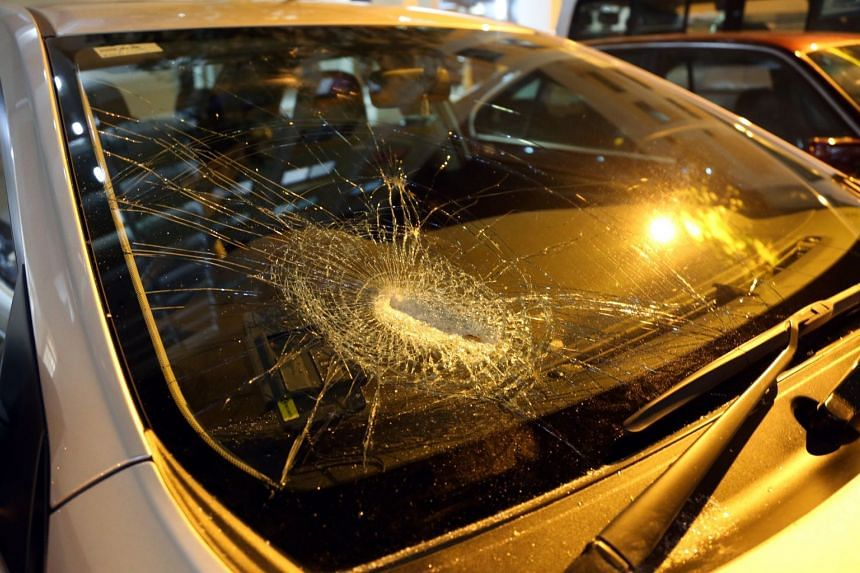 One of the items struck the windscreen of a car parked downstairs.
