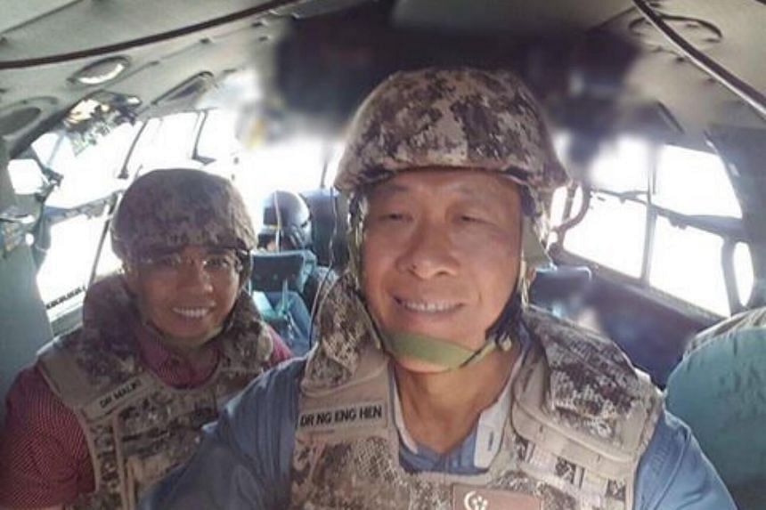 Minister for Defence Ng Eng Hen (right) and Senior Minister of State Maliki Osman on board a C-130 en route to visit SAF troops deployed to Iraq in support of a multinational coalition to defeat ISIS.