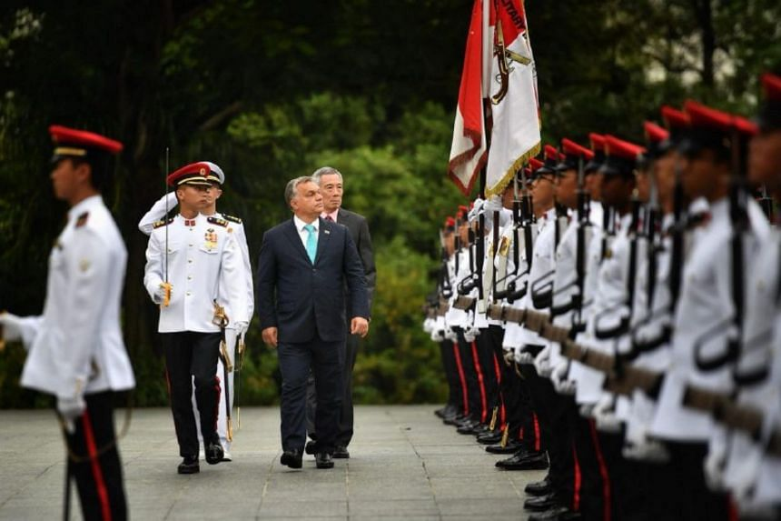 Hungarian PM Viktor Orban receives a ceremonial welcome at the Istana.