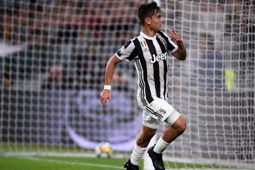 Juventus' forward from Argentina Paulo Dybala celebrates after scoring a goal during the italian Serie A football match Juventus vs Torino in Turin on Sept 23, 2017.