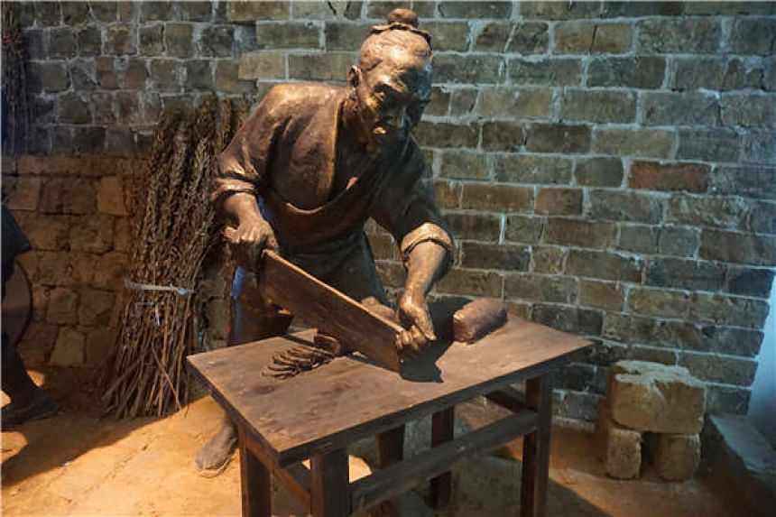 A statue immortalises techniques of sesame chip-making at the Xiaogan Museum of Sesame Chips & Rice Wine in Xiaogan city, Hubei province, on Sept 23, 2017.