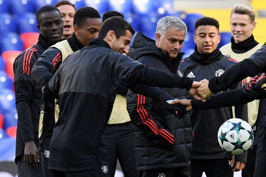 Mourinho and Manchester United players at a training session in Moscow, Sept 26, 2017.