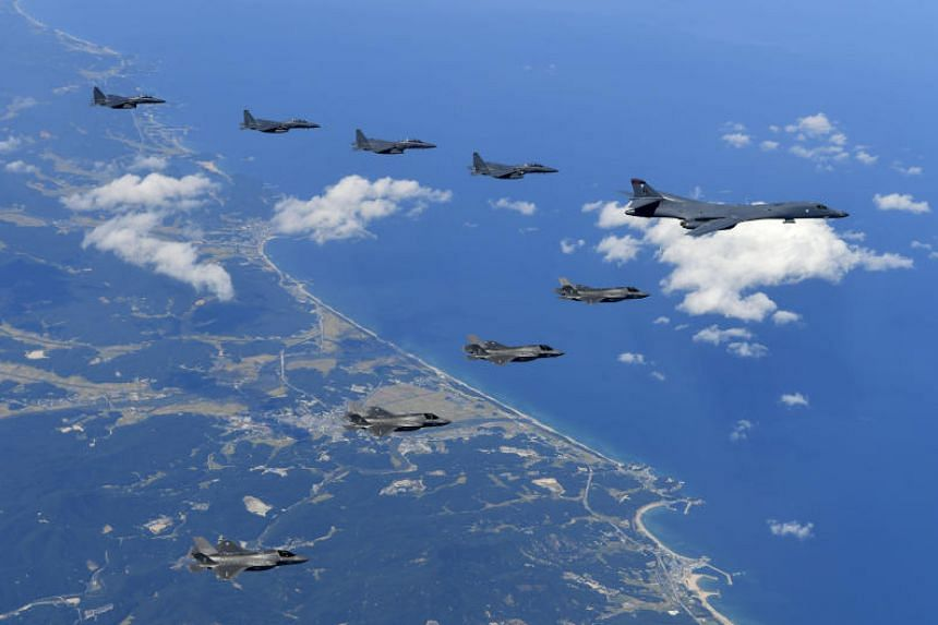 A US Air Force B-1B bomber, F-35B stealth fighter jets and South Korean F-15K fighter jets flying over South Korea during joint drills.