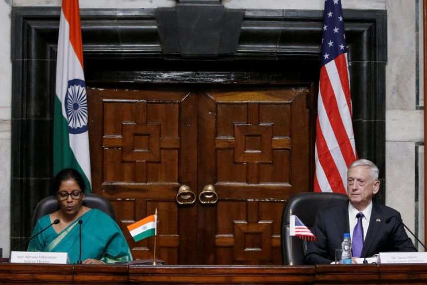 India's Defence Minister Nirmala Sitharaman speaks as US Defence Secretary James Mattis looks on during a joint news conference in New Delhi, India, on Sept 26, 2017.