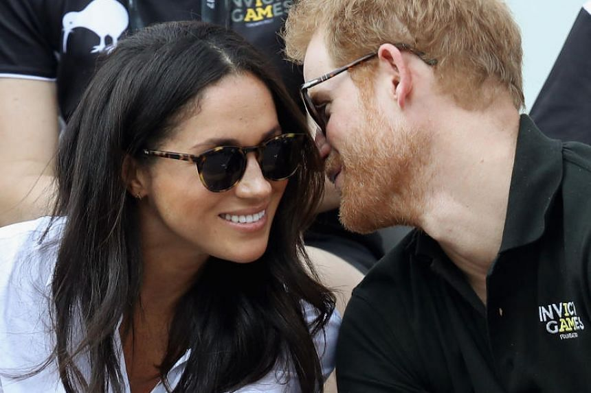 Prince Harry (right) and Meghan Markle (left) attend a Wheelchair Tennis match during the Invictus Games 2017 in Toronto, Canada on Sept 25, 2017.