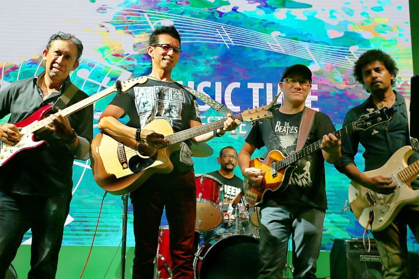 Project Schneider – comprising (from far left) Patrick Fernandez, 55, Joseph Lim, 64, Chris Ng, 52, Francis David, 55, and Gerald Pillai (on drums behind), 61 – rocking it at a community concert.