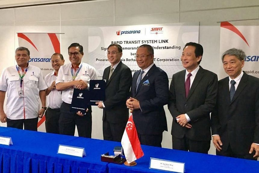 At the ceremony were (from left) Prasarana chairman Khalid Abu Bakar, Malaysia's Land Public Transport Commission chief development officer Prodyut Dutt, Prasarana president and group CEO Azmi Abdul Aziz, SMRT president and group CEO Desmond Kuek,