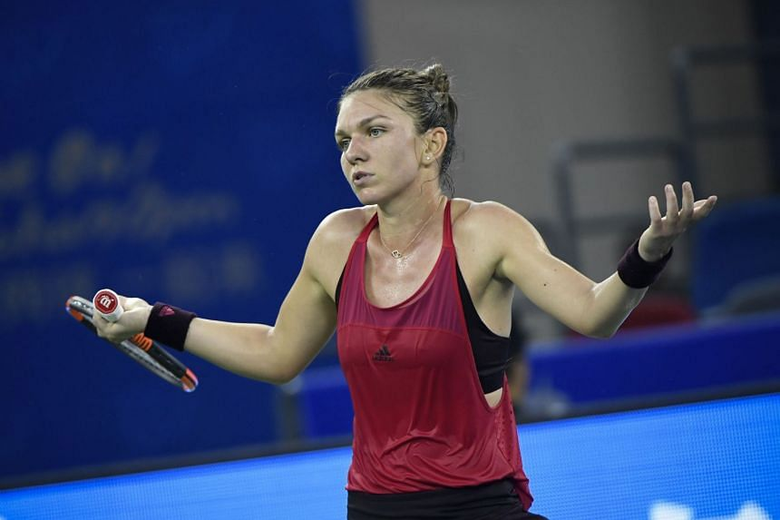 Simona Halep reacts after losing a point against Daria Kasatkina of Russia.