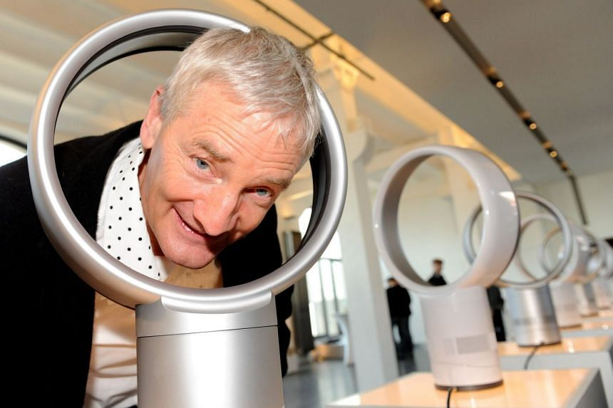 British designer and engineer James Dyson peeks through one of his company's bladeless fans in 2010.