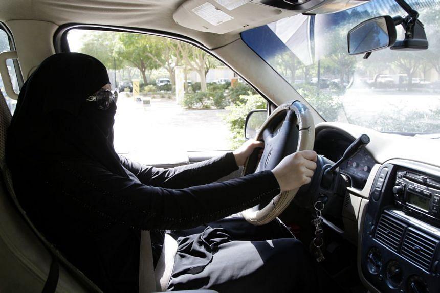 A Saudi woman sits behind the wheel of a car in Riyadh in a 2013 photo.