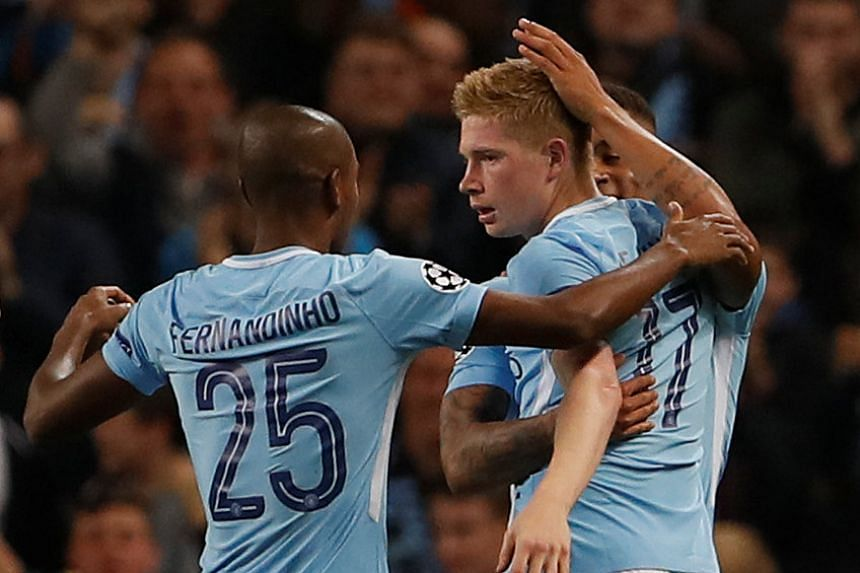 Manchester City's Kevin De Bruyne celebrates scoring their first goal with team mates.