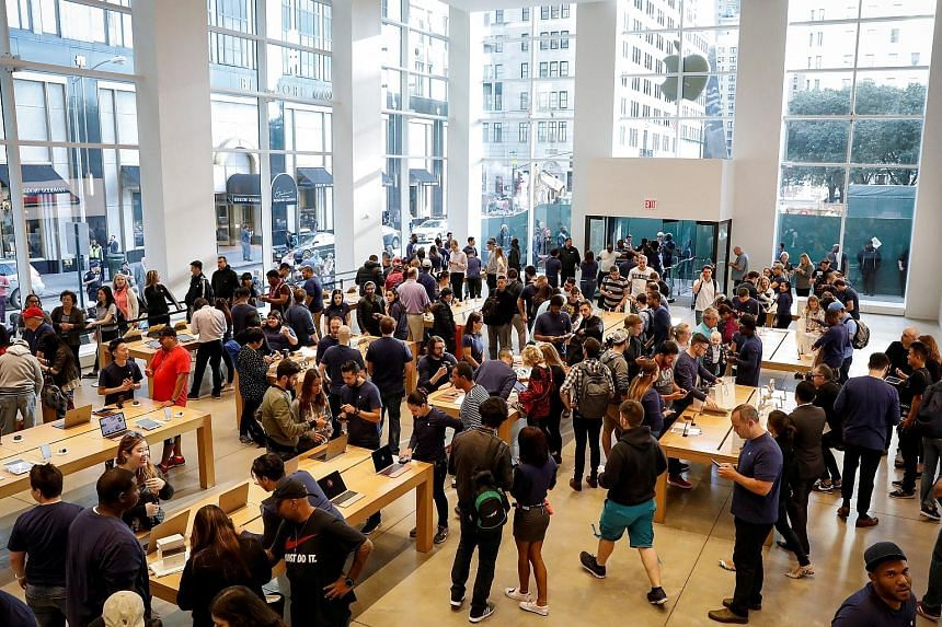 Customers checking out the iPhone 8 at the 5th Avenue Apple store in New York City last Friday.