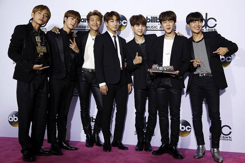 BTS with their Top Social Media Artist award at the Billboard Music Awards in May.