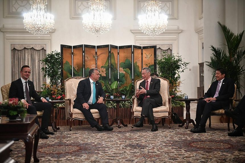 Prime Minister Lee Hsien Loong speaking with Hungarian Prime Minister Viktor Orban at the Istana yesterday. Flanking them are Hungarian Minister for Foreign Affairs and Trade Peter Szijjarto and Singapore's Minister for Education (Schools) and Second