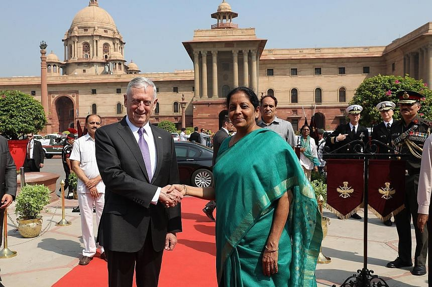 Indian Defence Minister Nirmala Sitharaman with US Secretary of Defence James Mattis upon his arrival at the Indian Defence Ministry in New Delhi yesterday. After talks with General Mattis, Ms Sitharaman said India was prepared to increase training f