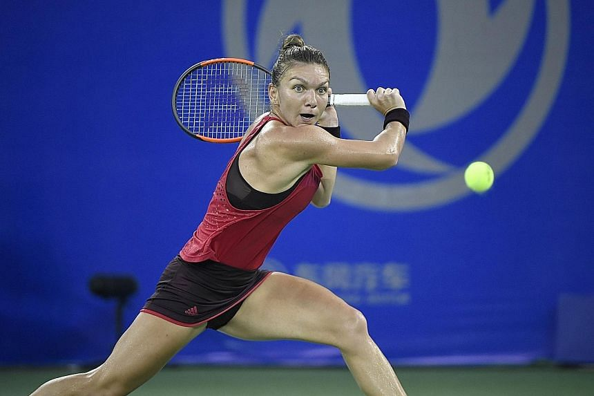 Romanian Simona Halep in action against Russian Daria Kasatkina during their second-round match. She joined the growing list of big-name Wuhan Open upsets.