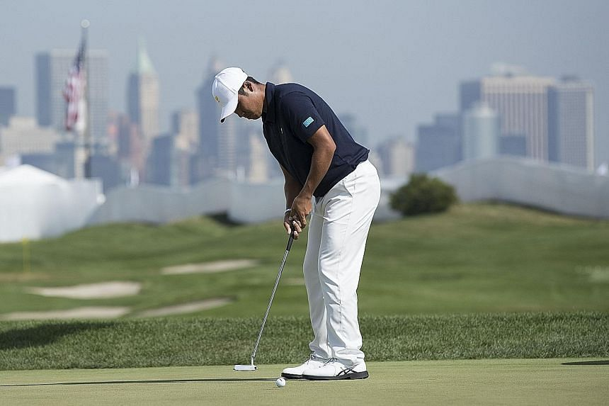International golfer Hideki Matsuyama practising on the putting green at Liberty National. He is the team's best ranked at world No. 3.