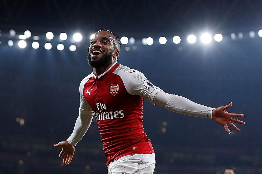 Alexandre Lacazette celebrating after scoring Arsenal's first goal, before netting from the spot to make it four goals since his close-season move from Lyon.
