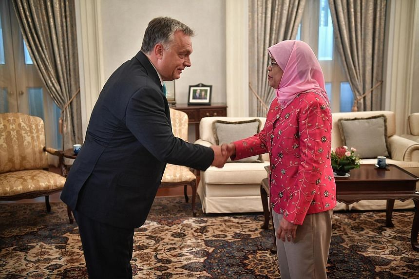 Hungarian Prime Minister Viktor Orban meeting President Halimah Yacob at the Istana yesterday. Mr Orban, who is here on a two-day official visit, was the first foreign leader to call on Madam Halimah since she was sworn in as President on Sept 14. Th