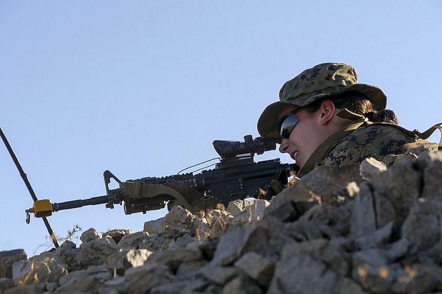 A US Marine Corps photo of an unidentified woman marine taking part in the Infantry Officer Course in California last week.