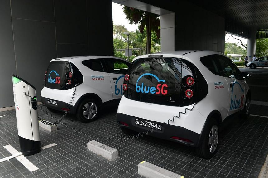 BlueSG electric cars being charged in Science Park Drive on Sept 27, 2017.