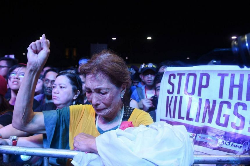 A protester raises a clenched fist during a rally at a park in Manila on Sept 21, 2017. The Social Weather Station said that forty-nine per cent of the country agrees with the statement, 'Many of those killed by the police in the anti-drug campaign a