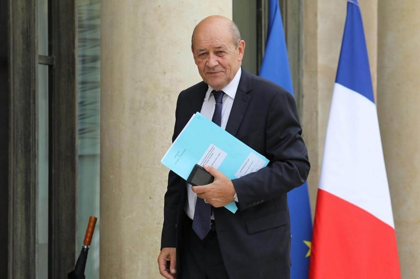 French Foreign Minister Jean-Yves Le Drian arrives at the Elysee palace in Paris on Sept 25, 2017.