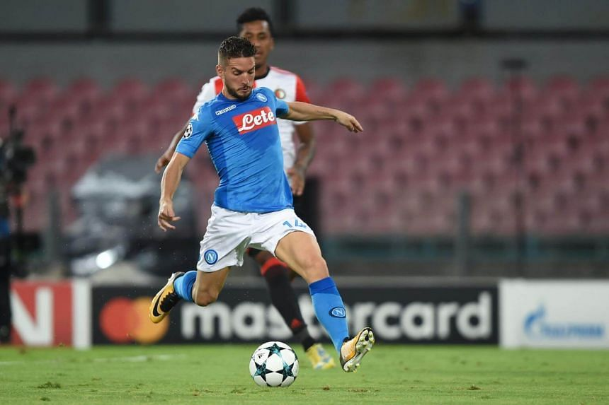 Napoli's forward from Belgium Dries Mertens scores during the UEFA Champion's League on Sept 26, 2017.