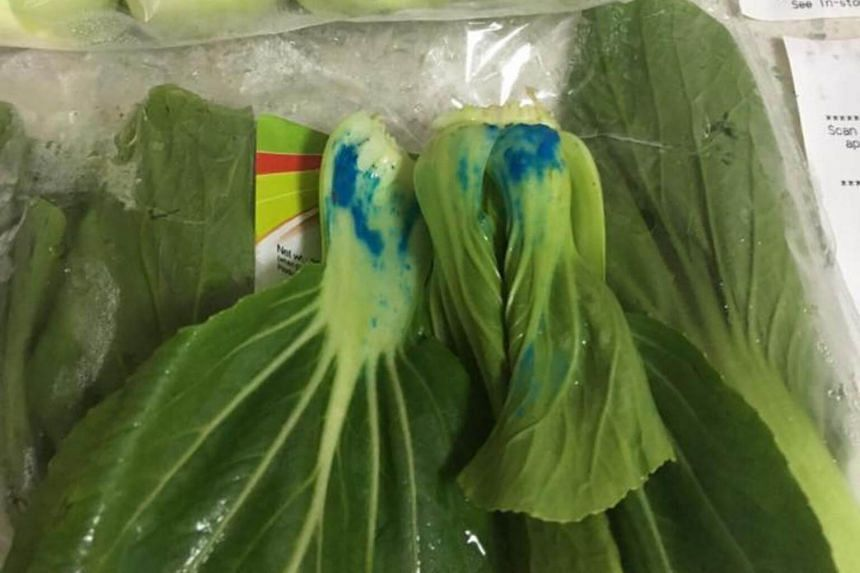 At least three consumers have posted photos of the affected vegetables on the NTUC FairPrice's Facebook page, asking for an explanation for the presence of the blue substance.