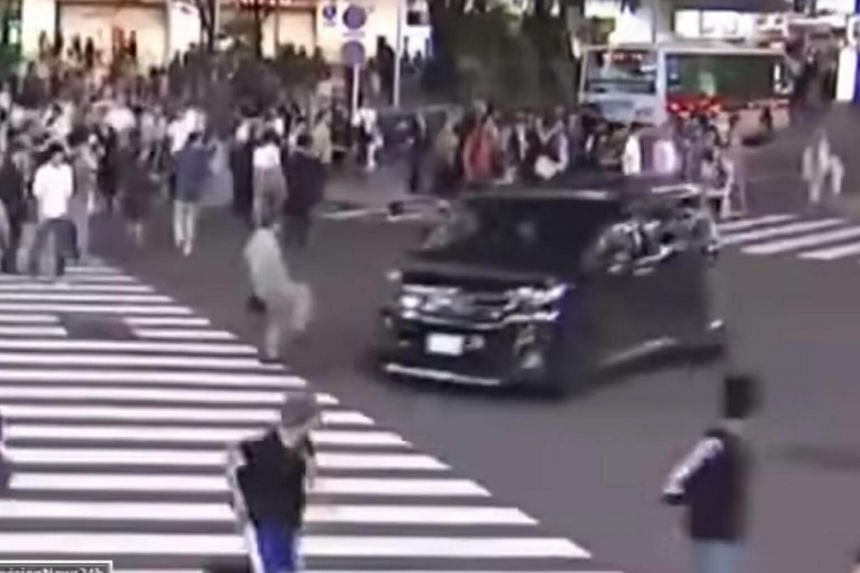 The van sped through the pedestrian-filled junction not once, but twice.