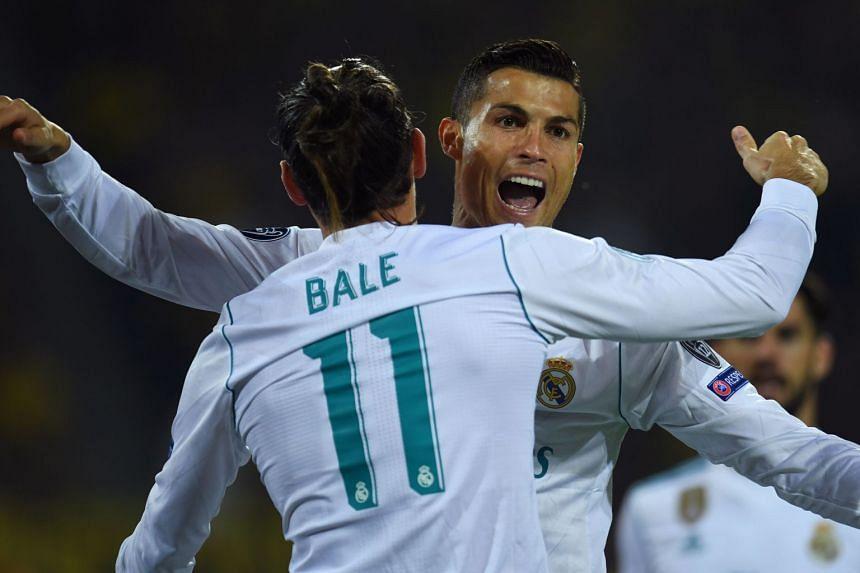 Cristiano Ronaldo (right) celebrates scoring with his team mate Gareth Bale.