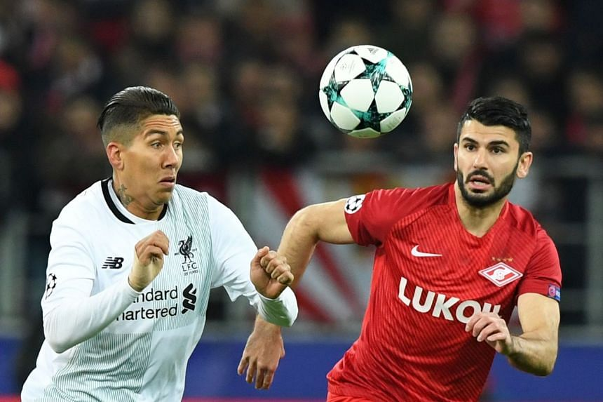 Liverpool's Roberto Firmino (left) and Spartak's Serdar Tasci vie for the ball.
