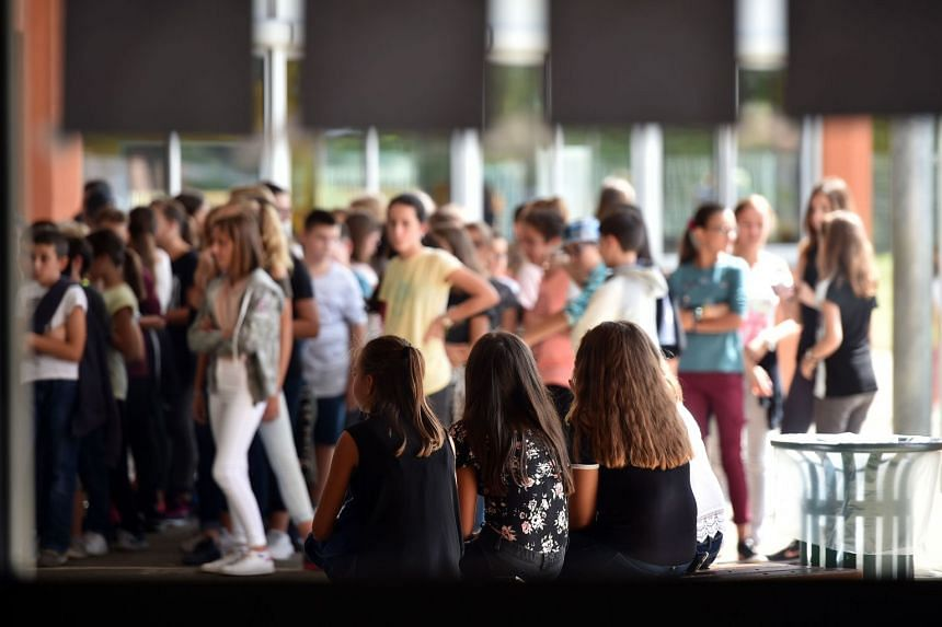 Children at the start of a new school year at a school in Toulouse, France, Sept 5, 2017.