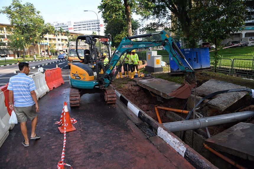 Repair works get under way at the site of the burst pipe at the junction of Bukit Batok West Ave 6 and Bukit Batok West Ave 8, on Sept 27, 2017.