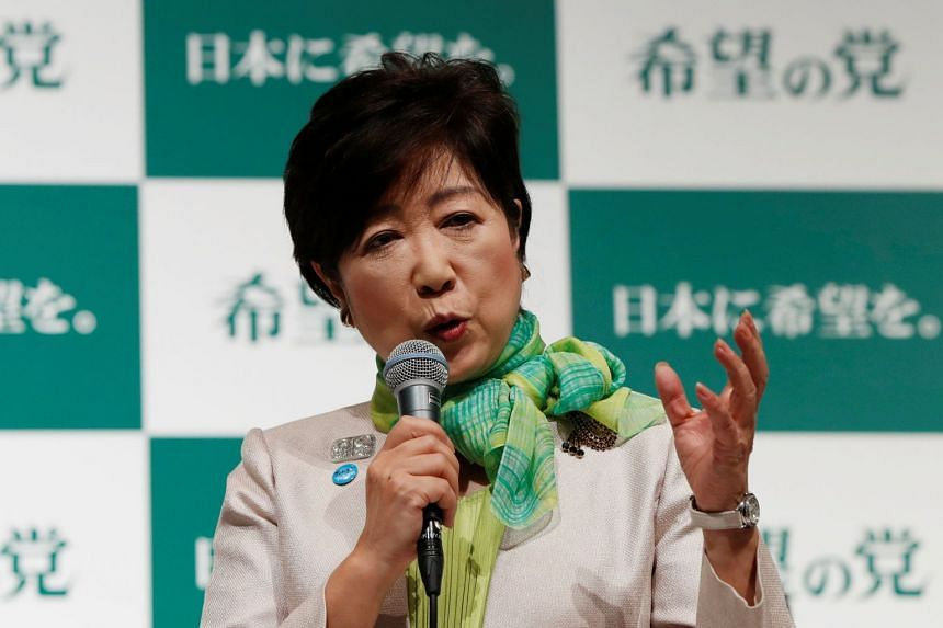Tokyo Governor Koike, leader of new Party of Hope, attends a news conference to announce the party's campaign platform with her party members in Tokyo.