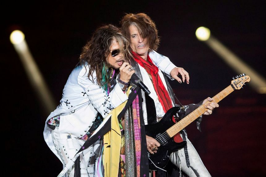 Vocalist Steven Tyler (left) and guitarist Joe Perry of Aerosmith perform during their Aerosmith: Let Rock Rule tour in Inglewood, California, on July 30, 2014.
