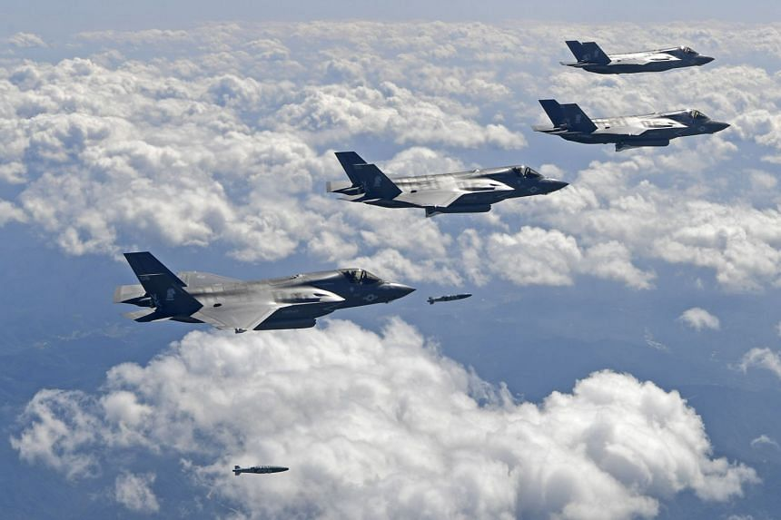 US F-35B stealth jet fighters dropping bombs at a shooting range in Gangwon Province, east of Seoul, during a joint military drill aimed to counter North Korea's latest nuclear and missile tests, on Sept 18, 2017.