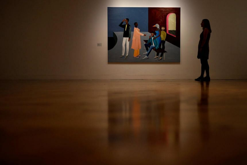 A gallery worker stands next to a painting by Turner Prize nominee Lubaina Himid at the press preview for the 2017 Turner Prize at Ferens Art Gallery in Hull, Britain, on Sept 25, 2017.