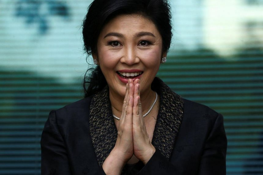 Ousted former Thai prime minister Yingluck Shinawatra greets supporters as she arrives at the Supreme Court in Bangkok, Thailand, on Aug 1, 2017.
