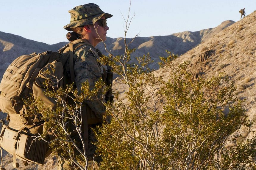 An unidentified Marine looks on as she participates in an exercise during the Infantry Officer Course at Marine Corps Air Ground Combat Centre.