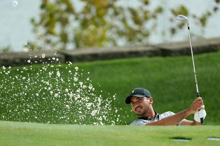 Jason Day of the International Team hits a shot during a practice round prior to the Presidents Cup.