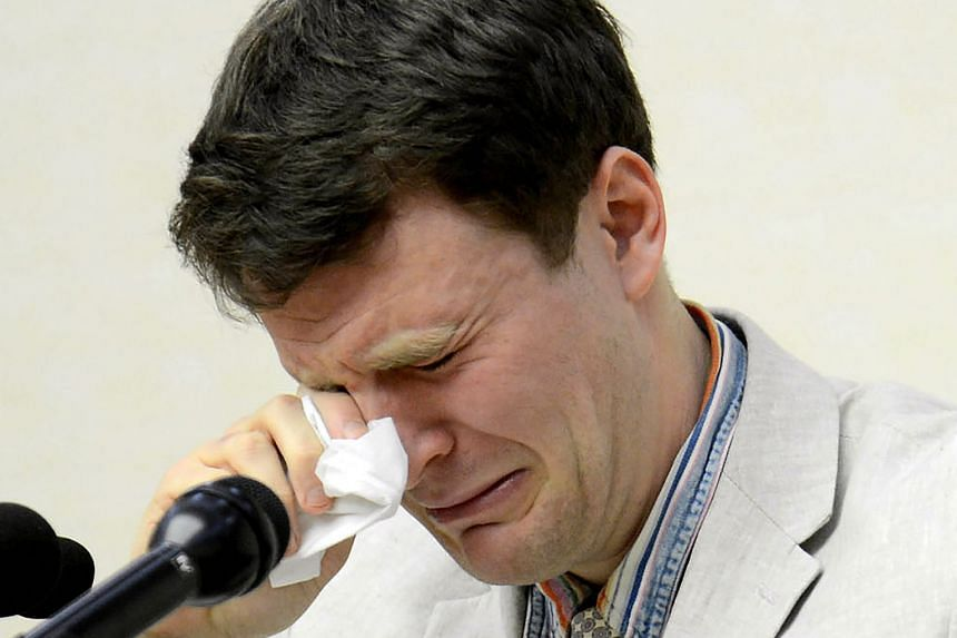 This file photo taken on Feb 29, 2016, and released by North Korea's official Korean Central News Agency (KCNA) on March 1, 2016, shows US student Otto Warmbier, who was arrested for committing hostile acts against North Korea, wiping his tears as he