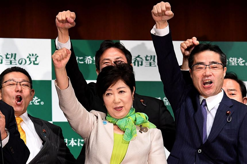 """Tokyo Governor Yuriko Koike (centre) poses with her party members during an inauguration press conference on her new political party, """"Party of Hope"""", in Tokyo on Sept 27, 2017."""